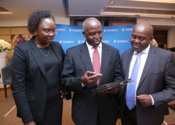 Mugo Kibati (R) with Sanlam Kenya Chief Financial Officer Victoria Impomai (Left) and Group Chairman Dr John Simba during the Sanlam Kenya Full Year 2016 Trading Results Release. Telkom Kenya hasppointed Kibati as its CEO to replace Aldo Mareuse www.exchange.co.tz