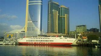 A shipped docked at the Port of Dar es Salaam in Tanzania with its towering 35 story single clearance building. In the background are the PPF twin towers. Bank of Tanzania says the banking sector is sound and growing. Photo: Trip Advisor