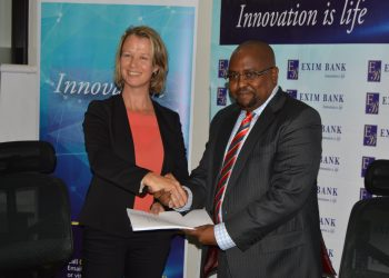 Deputy CEO of Exim Bank Tanzania, Jaffari Matundu shakes hands with Marleen Jansen, Senior Investment Officer of FMO-a Dutch development bank yesterday after signing an agreement for a financial closure of TZS 75 Billion to finance and support long-term lending to small and medium-sized enterprises (SMEs) in Tanzania.