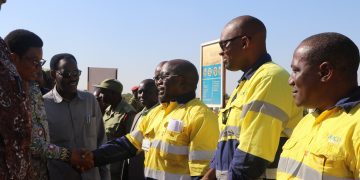 Acacia Mining Managing Director for Tanzania, Asa Mwaipopo welcomes Prime Minister Kassim Majaliwa when the latter visited Buzwagi Gold Mine over the weekend