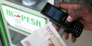 An M-Pesa transaction. The Communications Authority of Kenya (CA) says that 97 out of 100 Kenyans have mobile phones, transacting almost Sh2 Trillion in three months www.exchange.co.tz
