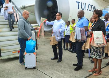 Tourism-Wildlife-CS-Najib-Balala-presents-gift-mementoes-to-passengers-disembarking-from-a-TUI-charter-flight-from-The-Netherlands- The exchange