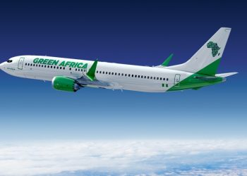 A Green Africa Airways promo plane in flight. The Lagos-based airline and Boeing have announced a commitment for up to 100 737 MAX 8 aircraft. www.exchange.co.tz