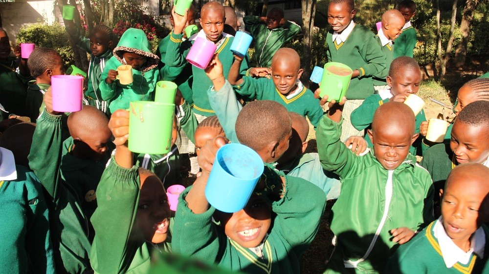 Pupils at Oserian Primary School enjoying a cup of uji in their first day of school in 2019. This follows the introduction of the school feeding programme by Oserian Development Company. www.exchange.co.tz