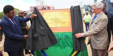 Prime Minister of Tanzania, Hon. Kassim Majaliwa and CSTC Chairman Mr.Gerald Billet pulling the curtain to signal opening of the Cassava Starch of Tanzania Corporation.- The Exchange