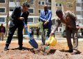 From L-R:Karibu Homes Founder and Managing Director Mr. Ravi Kohli, Shelter Afrique Managing Director & CEO Andrew Chimphondah, and Shelter Afrique Chairman Daniel Nghidinua plant and water a tree to mark the launch of phase II of Karibu Homes. The housing project was funded by Shelter Afrique at a cost of Ksh355 million.