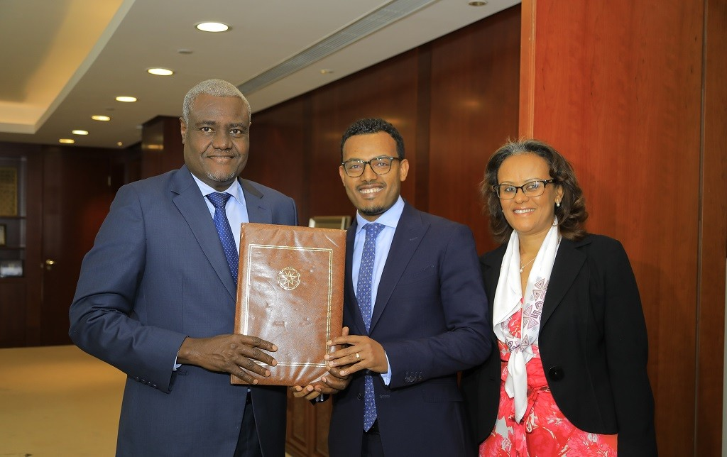 AU Commission Chairperson Moussa Faki Mahamat receives Ethiopia's ratification deposit from the representatives of the Federal Republic of Ethiopia on Wednesday in Addis Ababa. www.exchange.co.tz